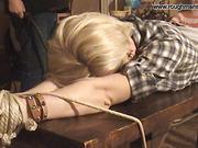 Bondaged blonde gets whipping