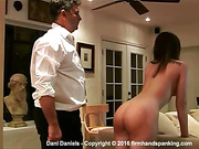 Totally nude Dani Daniels bends over
