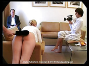 Amelia's bare bottom burns from a spanking
