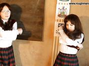 Two schoolgirls get cane in the classroom