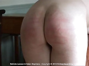 Belinda Lawson's peachy bottom is caned